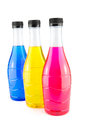 Bright colorful bottles water in on white background Stock Images