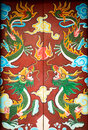 Title: Colorful door with symmetrical dragon painting.