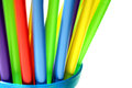 Bright Colorful Plastic Straws in Blue Cup Stock Photography