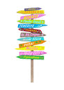 Bright colorful wooden directional beach signs with text on pole Royalty Free Stock Photo
