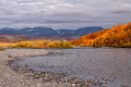 The bright colors of autumn in the mountains and on the river. Royalty Free Stock Photo
