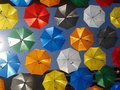 Bright coloured umbrellas hanging above the high street in gandia are these wonderfully colourful they offer both shade and a Stock Photos
