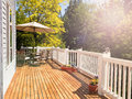 Bright daylight falling on home outdoor deck Royalty Free Stock Photo