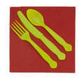 Bright disposable plastic cutlery knife fork and s unusual colour choice yellow green red Stock Photo