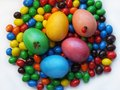 Bright easter eggs on the background of candies Stock Photography