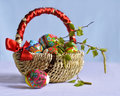 Bright easter eggs in the basket colorful on a blue background Royalty Free Stock Photos