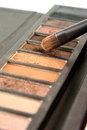 Bright eye shadows and brush close up Stock Image