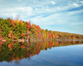 Bright fall colors reflecting in the bays mountain lake in kingsport tennessee beautiful autumn hardwood trees their vibrant Stock Photography
