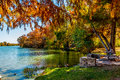 Bright fall foliage and picnic table on Texas river. Royalty Free Stock Photo