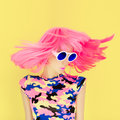 Bright fashion girl in motion on a yellow background Royalty Free Stock Photography