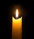 Bright flame of a candle in the dark Royalty Free Stock Photo