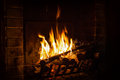 Bright flame of fire burns in a fireplace Royalty Free Stock Photo