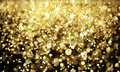 Bright gold glitter out focus Royalty Free Stock Images