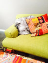 Bright green sofa with colorful cushions Royalty Free Stock Photo