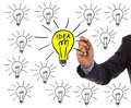 Bright idea businessman drawing a light bulb on a whiteboard concept for and inspiration Stock Images