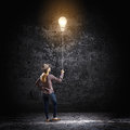Bright idea young woman in casual holding bulb balloon Stock Image