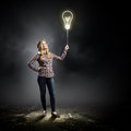 Bright idea young woman in casual holding bulb balloon Royalty Free Stock Images