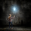Bright idea young woman in casual holding bulb balloon Royalty Free Stock Photos