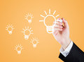 Bright ideas hand drawing light bulb with marker Royalty Free Stock Photos