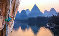 Bright Image of Young Rock Climber Sunrise karst Mountains in China and River Royalty Free Stock Photo