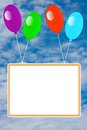 Bright inflatable balloons with a clean placard fly highly in blue sky Royalty Free Stock Photography