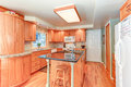 Bright kitchen interior with oak wood cabinetry Royalty Free Stock Photo