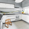 Bright kitchen with step stool Royalty Free Stock Photo