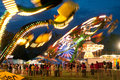 Bright Lights Of Carnival Rides Motion Blur Stock Photo