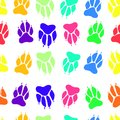 Bright multicolored paw print dog imprint seamless pattern, vect Royalty Free Stock Photo
