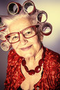 Bright old woman portrait of an elderly in curlers looking at camera Royalty Free Stock Images