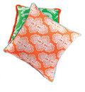 Bright orange and green pillows Stock Photos