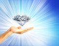 Bright picture of hand with big diamond. Royalty Free Stock Photo