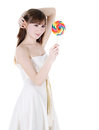 Bright picture of happy blondie with color lollipop