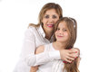 Bright picture of hugging mother and daughter isolated Stock Photo