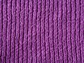 Bright pink lilac wool hand knitted texture abstract background Royalty Free Stock Photo