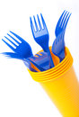Bright plastic tableware cups and forks on white background se yellow blue selective focus Stock Image