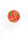 Bright rainbow round lollipop. Isolated on white background Royalty Free Stock Photo