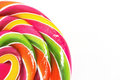 Bright rainbow round lollipop. Isolated on white background.Copy Royalty Free Stock Photo