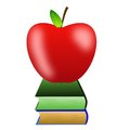 Bright red apple and two books on a white background Royalty Free Stock Image