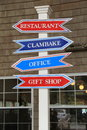 Bright red and blue signs on post at seaside restaurant colorful tall outside Royalty Free Stock Photography