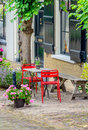 Bright red chairs in front of a historic Dutch house Royalty Free Stock Photo