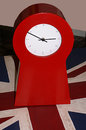 Bright red clock with small numbers on white face Stock Photo