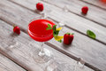 Bright red drink in glass. Royalty Free Stock Photo