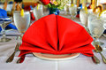 Bright red linen napkin fan shaped on dinner party table Royalty Free Stock Photos