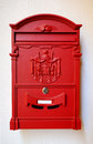 A bright red post box. Royalty Free Stock Photo