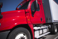 Bright red semi truck with trailer in close up view Royalty Free Stock Photo