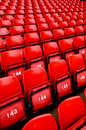 Bright red stadium seats Stock Images