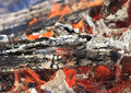Bright red tongues of flame and glowing white hot coals Stock Image