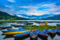 Bright Row Boats - Lake Phewa, Pokhara, Nepal. Royalty Free Stock Photo