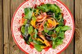 Bright salad with vegetables: spinach, tomatoes, olives, onion a Royalty Free Stock Photo